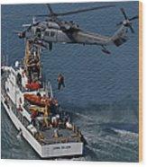 An Hh-60g Pave Hawk Performs A Hoist Wood Print