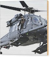 An Hh-60g Pavehawk Helicopter In Flight Wood Print