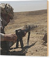 An Iraqi Army Soldier Prepares To Fire Wood Print