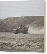 An M-atv Races Across The Wadi Wood Print