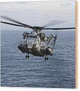 An Mh-53e Sea Dragon In Flight Wood Print