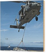 An Mh-60s Sea Hawk Helicopter Lowers Wood Print