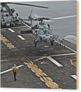An Mh-60s Sea Hawk Lands Aboard Wood Print