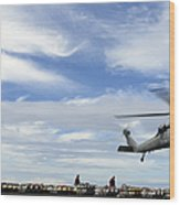 An Mh-60s Sea Hawk Lifts A Pallet Wood Print