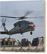 An Mh-60s Sea Hawk Lifts Cargo Wood Print