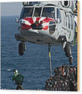 An Mh-60s Sea Hawk Picks Up Pallets Wood Print