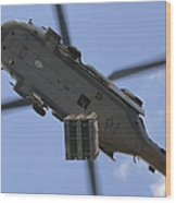 An Mh-60s Seahawk Helicopter Airlifts Wood Print