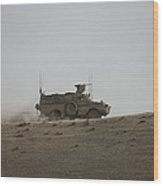 An Mrap Vehicle Patrols The Ridge Wood Print