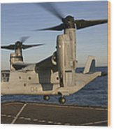 An Mv-22 Osprey Lands Aboard Usns Wood Print