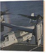 An Mv-22 Osprey Prepares To Land Aboard Wood Print