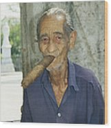 An Old Man Smokes An Over-sized Cigar Wood Print