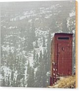 An Outhouse Perches On A Hillside Wood Print by Rex A. Stucky