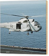 An Sh-3h Sea King Helicopter Prepares Wood Print