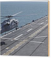 An Sh-60 Sea Hawk Helicopter Lands Wood Print