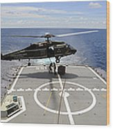 An Sh-60f Sea Hawk Helicopter Lowers Wood Print