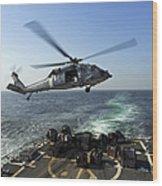 An Sh-60r Sea Hawk Delivers Pallets Wood Print