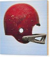 Antique Football Helmet On Blue Background Wood Print