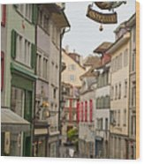 Antique Shop Sign On A Shopping Street Wood Print