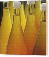 Apple Juice In Bottles Wood Print