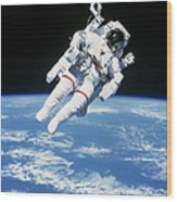 Astronaut Floating In Space Wood Print