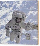 Astronaut Gernhardt On Robot Arm Wood Print