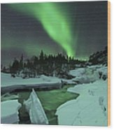Aurora Borealis Over A Frozen Tennevik Wood Print