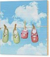 Baby Shoesr And Teddy Bear On Clothline Wood Print