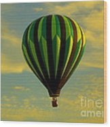 Balloon Ride Through Gold Clouds Wood Print