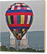 Ballooning Between The Stacks Wood Print