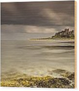 Bamburgh Castle Under A Cloudy Sky Wood Print by John Short