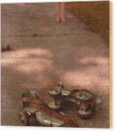 Barefoot Girl On Sidewalk With Roller Skates Wood Print