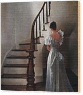 Beautiful Young Woman Standing In Gown By Stairs Wood Print