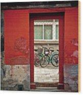 Bicycles In Red Doorway Wood Print