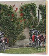 Bicycles Parked By The Wall Wood Print
