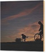 Bicyclist And Pet Silhouetted Wood Print
