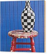Blach And White Vase On Stool Against Blue Wall Wood Print