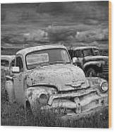 Black And White Photograph Of A Junk Yard With Vintage Auto Bodies Wood Print