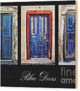 Blue Doors Of Santorini Wood Print by Meirion Matthias
