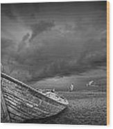 Boat Stranded On A Beach Covered By Menacing Storm Clouds Wood Print