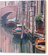 Boats Bridge And Reflections In A Venice Canal Wood Print