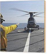Boatswain's Mate Directs A Ch-46 Sea Wood Print