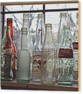 Bottles On The Shelf Wood Print