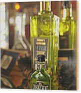 Bottles With Absinthe In Bar Wood Print