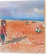 Boy At Beach Playing And Chasing Ball Wood Print