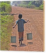 Boy Carrying Drinking Water Wood Print