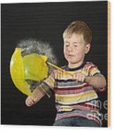 Boy Popping A Balloon Wood Print