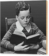 Boy Reading Book At Desk Wood Print