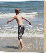 Boy Running Into Surf Wood Print