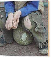 Boy Sitting On Ball - Torn Trousers Wood Print