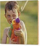 Boy Spraying Water Gun Wood Print